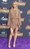 Gwyneth Paltrow Looks Like She Has Legs For Dayyys in This Sexy Gold Minidress