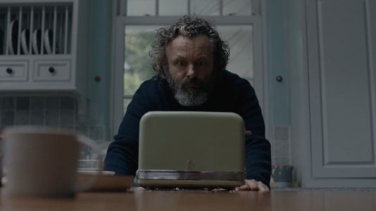 "Michael Sheen Faces Down A Toaster In Kelly Lee Owens' ""Corner Of My Sky"" Video"