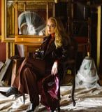 """Adele's Oxblood Leather Trench Coat Was the True Star of the """"Easy On Me"""" Music Video"""
