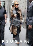 Jennifer Lopez Wears Her Leopard Trench With a Blinged-Out Water Bottle, Because Glamour