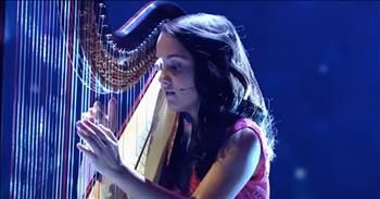 Child Prodigy Daria Vacaroiu Performs Harp Rendition Of 'Believe'