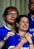 Ed Sheeran Flashes a Smile While Holding His Fiancée Close During a Game in England