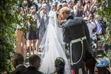 Prince Harry and Meghan Markle Celebrate Their 1st Anniversary With Behind-the-Scenes Wedding Photos