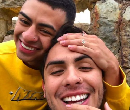 """This Dad """"Shows Off"""" Photos of His Son With His Boyfriend at Work, and It's Beyond Sweet"""