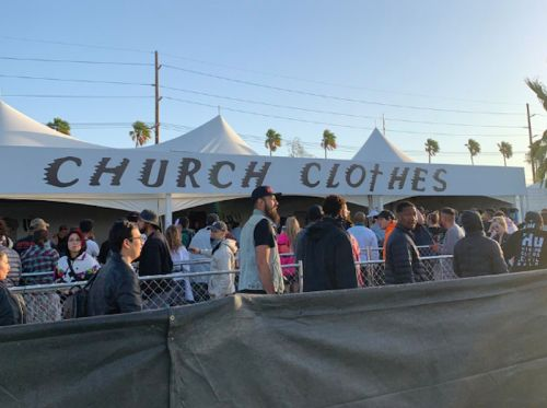 "Kanye West sells Sunday Service ""church clothes"" at Coachella"