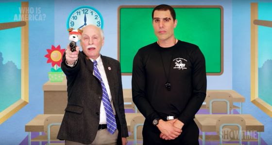 Sacha Baron Cohen Gets Politicians to Cite Cardi B, Blink-182 as Reasons to Arm Kids
