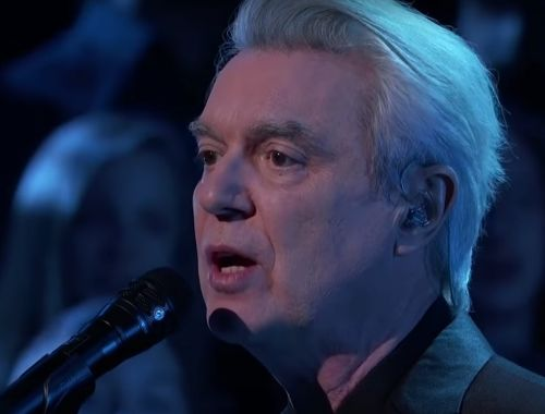 "Watch David Byrne & The Brooklyn Youth Chorus' Stunning Performance Of ""One Fine Day"" On Kimmel"